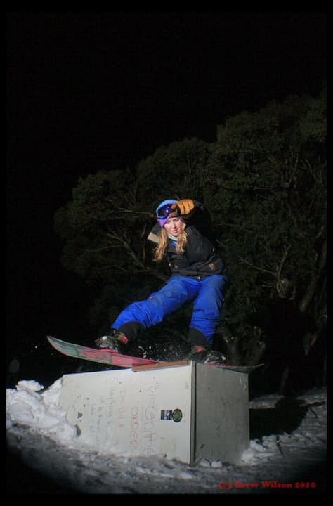 female snowboarder jibbing a fridge