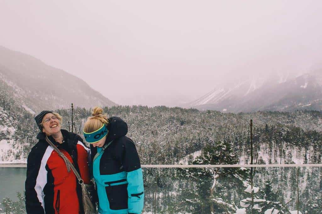 Me and my mum laughing about something while traveling together in winter in the Alps