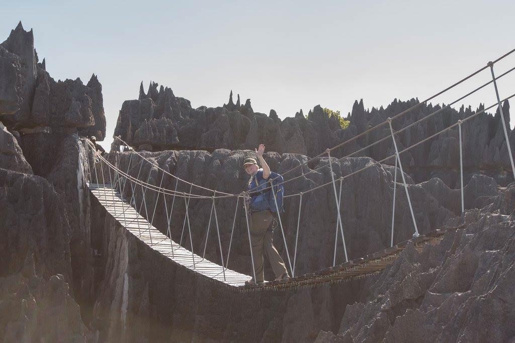 crossing a via ferrata suspension bridge in Madagascar