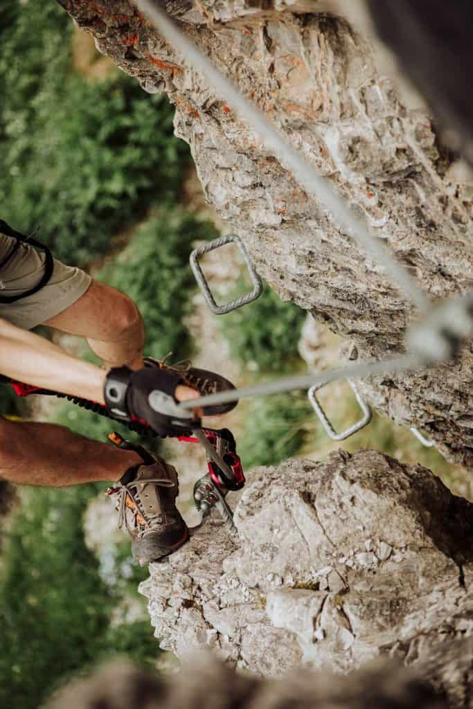 Climbing via ferrata in gloves